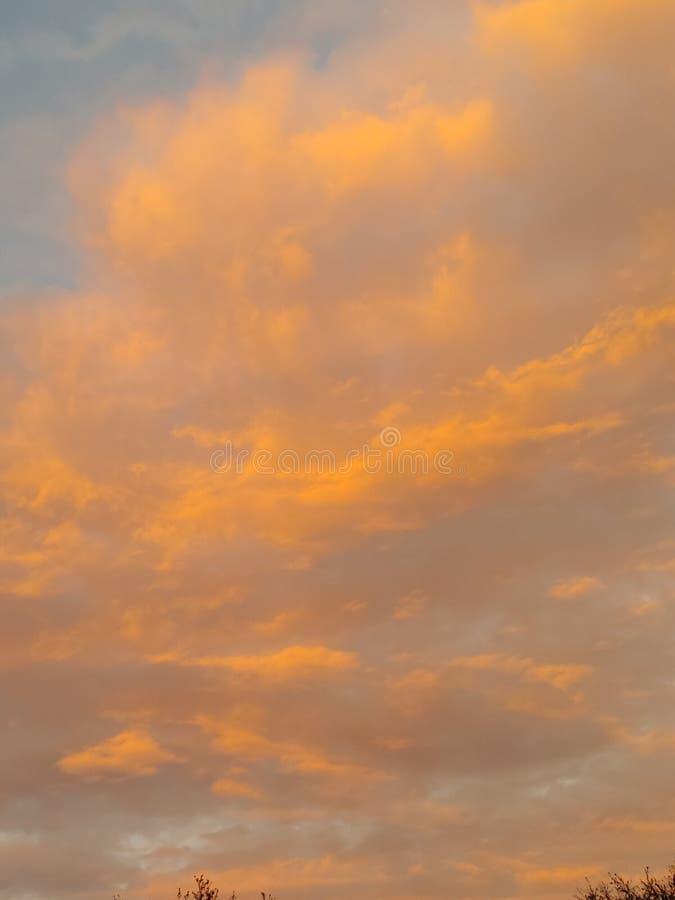 Cloud sunset sky. Low cloud sunrise sky. Peach, blue royalty free stock photos