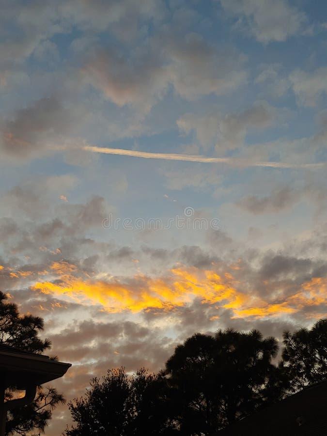 Cloud sunset sky. Low cloud sunrise sky. Peach, blue royalty free stock image