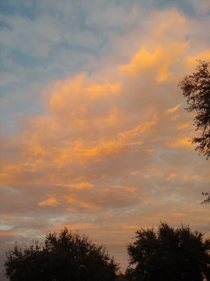 Cloud sunset sky. Low cloud sunrise sky. Peach, blue royalty free stock photo