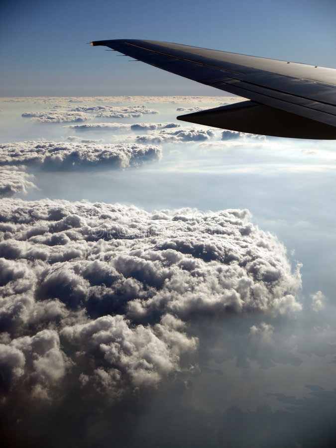 Cloud Trail pattern with Airplane wing royalty free stock photos