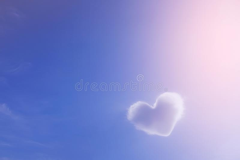 A cloud of white in the shape of a heart against a beautiful idyllic blue sky, a symbol of love. The concept of imagination, vector illustration