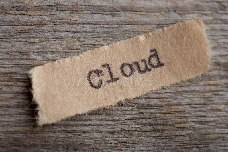 Cloud word on a piece of paper close up, business modern technology concept stock image