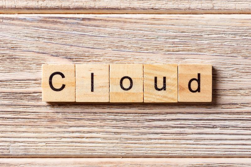 Cloud word written on wood block. cloud text on table, concept stock photo