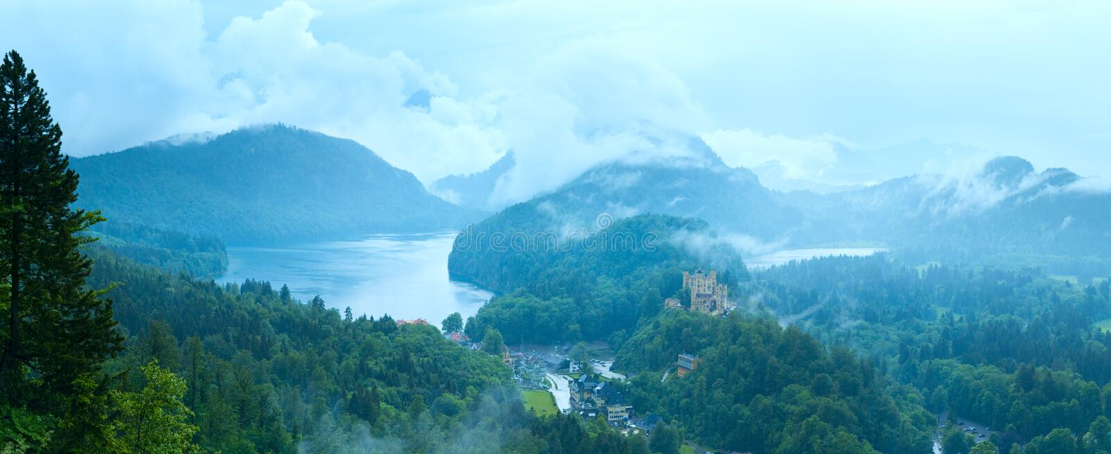 Cloudburst above Neuschwanstein Castle in Bavaria. Cloudburst above historic medieval Neuschwanstein Castle in Bavaria (Germany). View from Neuschwanstein Palace royalty free stock photography