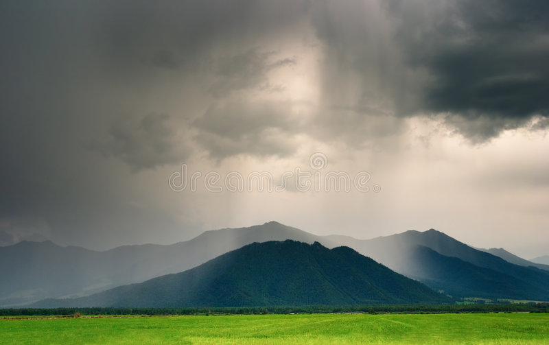 Cloudburst in mountains. Landscape with mountains and cloudy sky royalty free stock photography