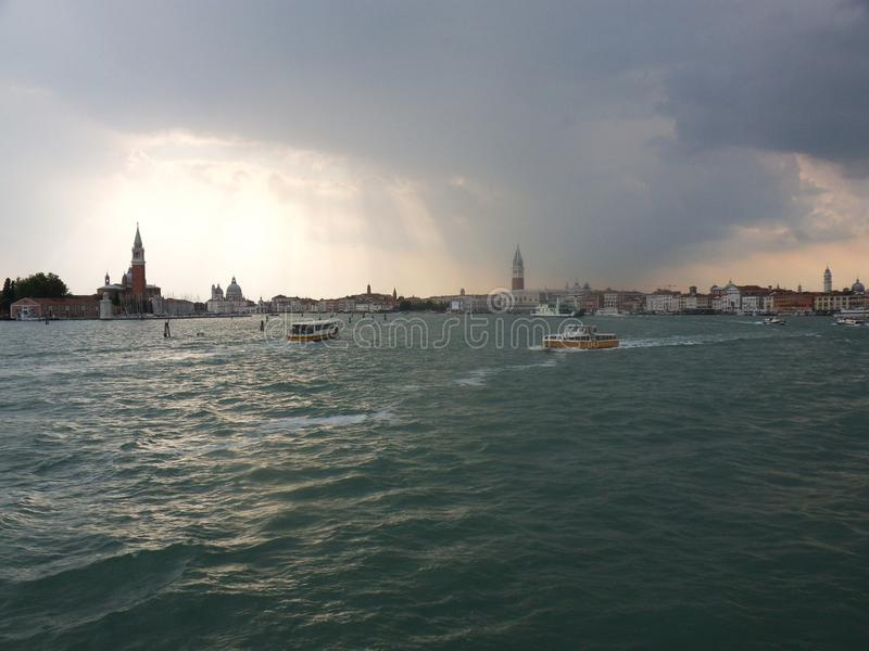 Cloudburst at Piazza San Marco. Venice, Veneto, Italy - June 2, 2014: it looks like a storm is breaking down is the Piazza San Marco stock images
