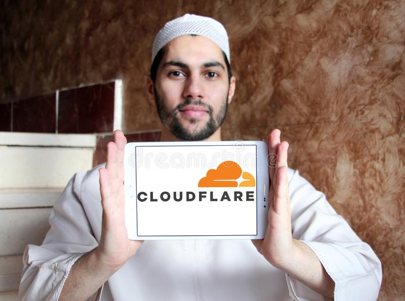 Cloudflare company logo. Logo of Cloudflare company on samsung tablet holded by arab muslim man. Cloudflare is a U.S. company that provides a content delivery royalty free stock photo