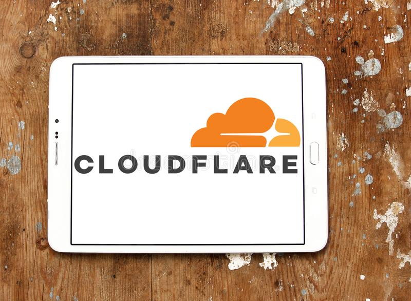 Cloudflare company logo. Logo of Cloudflare company on samsung tablet on wooden background. Cloudflare is a U.S. company that provides a content delivery network royalty free stock photo