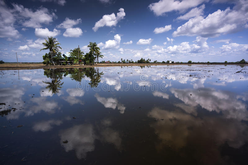 Cloudly day. Kampung house winding day love this reflection stock image