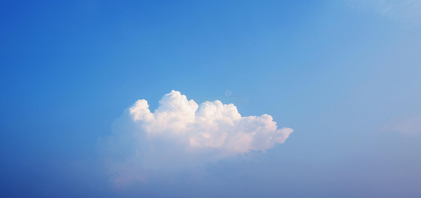 Clouds. White clouds with blue sky at dusk stock images