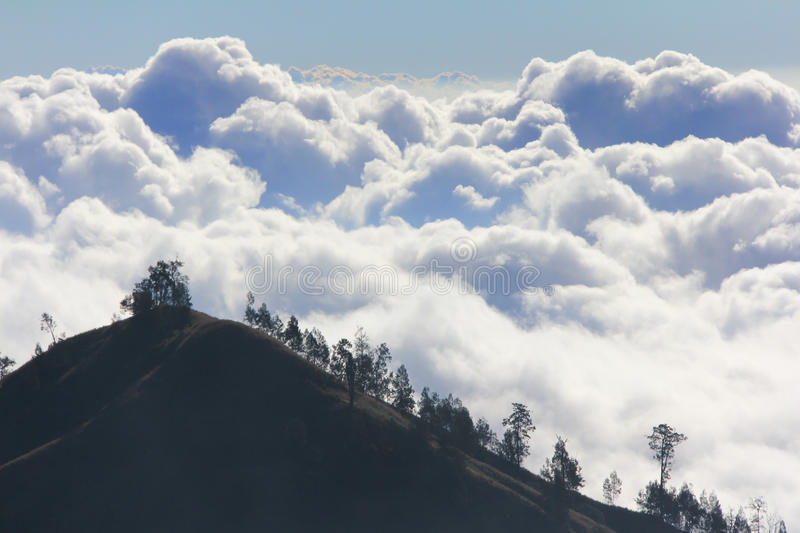 Clouds above mountain high royalty free stock photo