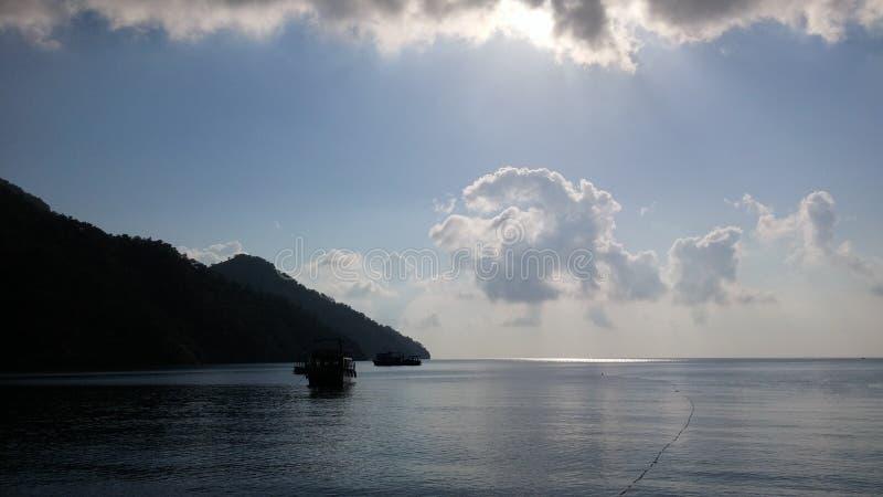 Clouds above the sea. Adrasan Beach Turkey sunrise royalty free stock photos