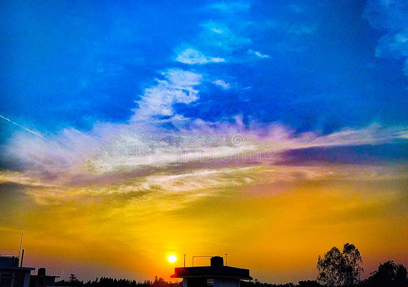 Clouds acts like horizon . Clouds  acts   like horizon diving the sky into two upper blue and lower yellow stock image
