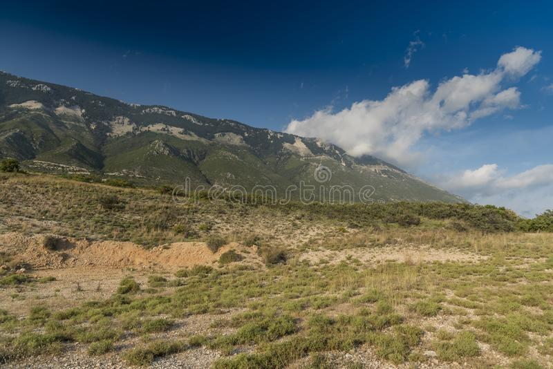 Clouds over Ainos Oros mountain southern Kefalonia. Clouds and Ainos Oros mountain southern Kefalonia. Kefalonia is an island in the Ionian Sea, west of mainland royalty free stock photos