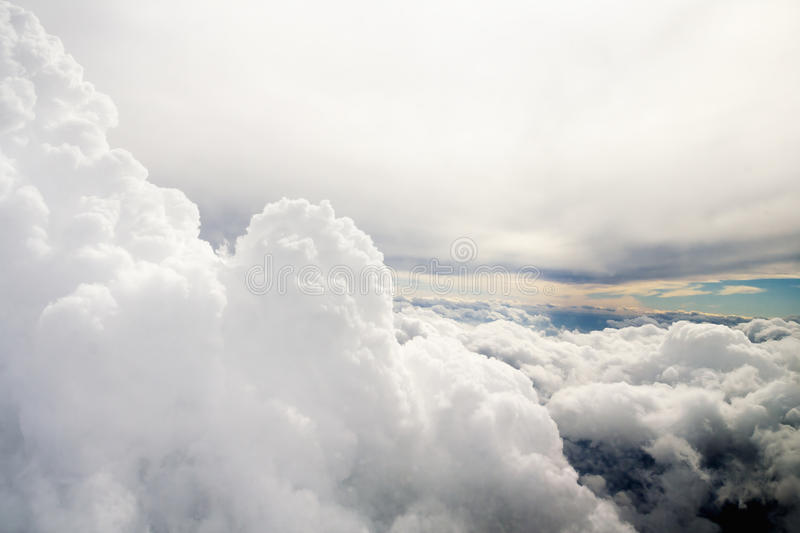 Clouds as seen through window of an aircraft stock images
