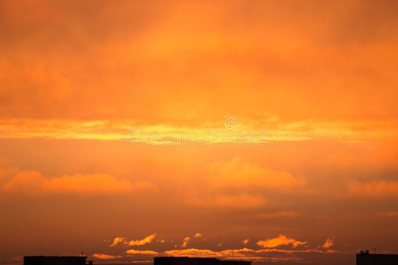 Clouds at dawn. Fiery red rising sun behind the clouds. headpiece. Clouds at the awn. Fiery red rising sun behind the clouds. headpiece royalty free stock images