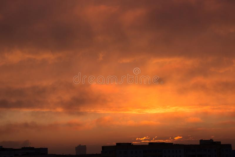 Clouds at dawn. Fiery red rising sun behind the clouds. headpiece. Clouds at the awn. Fiery red rising sun behind the clouds. headpiece stock photography