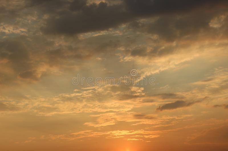 Clouds at dawn. Fiery red rising sun behind the clouds. headpiece royalty free stock photos