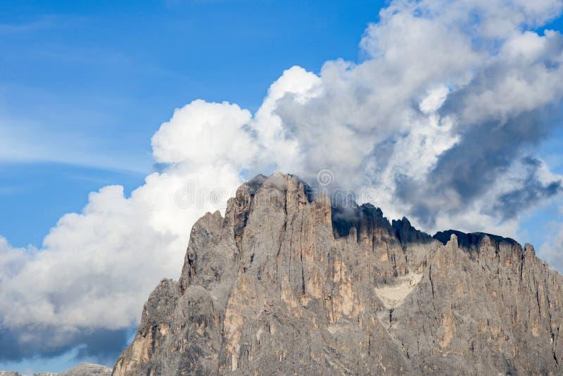 Cumulonimbus clouds behind Peaks of Dolomites Alpe di Siusi, South Tyrol stock image