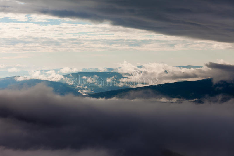 Download Clouds Billow Between Hill And Mountain Landscape Stock Photo - Image: 26999000