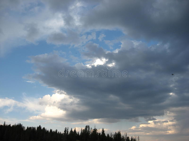 Clouds blowing through stock photography