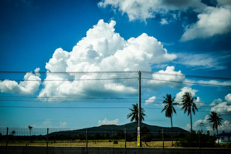 Clouds in blue skies over power lines royalty free stock image