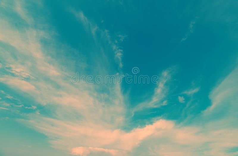 Clouds in the blue sky. Beautiful colorful sky with clouds. Color toned stock photography