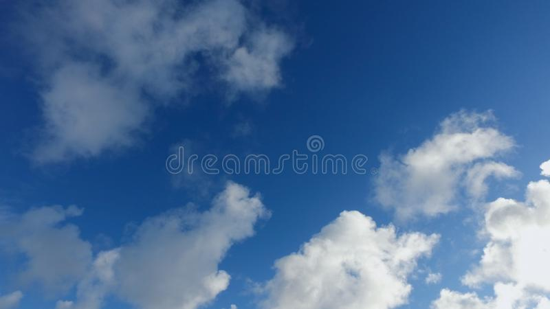 Clouds on a blue sky. In cold winter day stock image