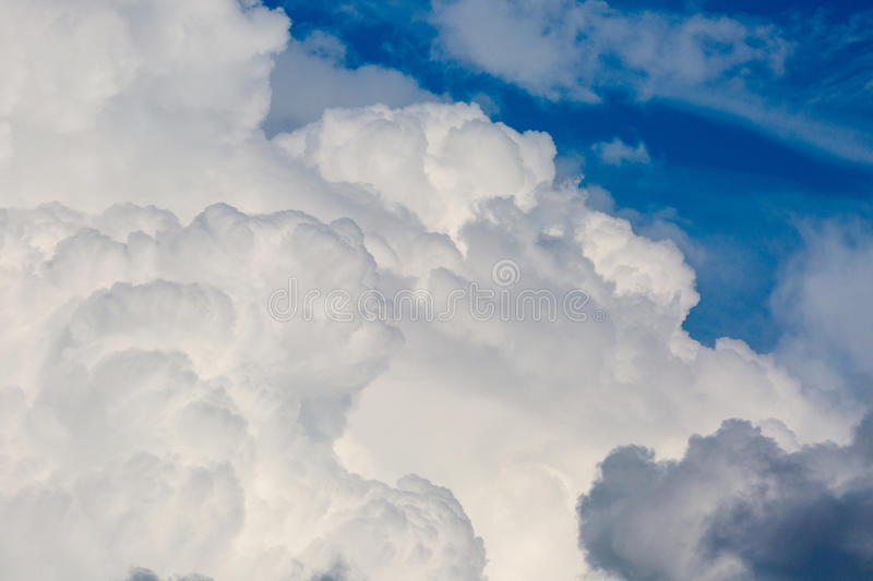 Clouds on blue sky. Cumulus clouds white and dark on blue sky royalty free stock photos
