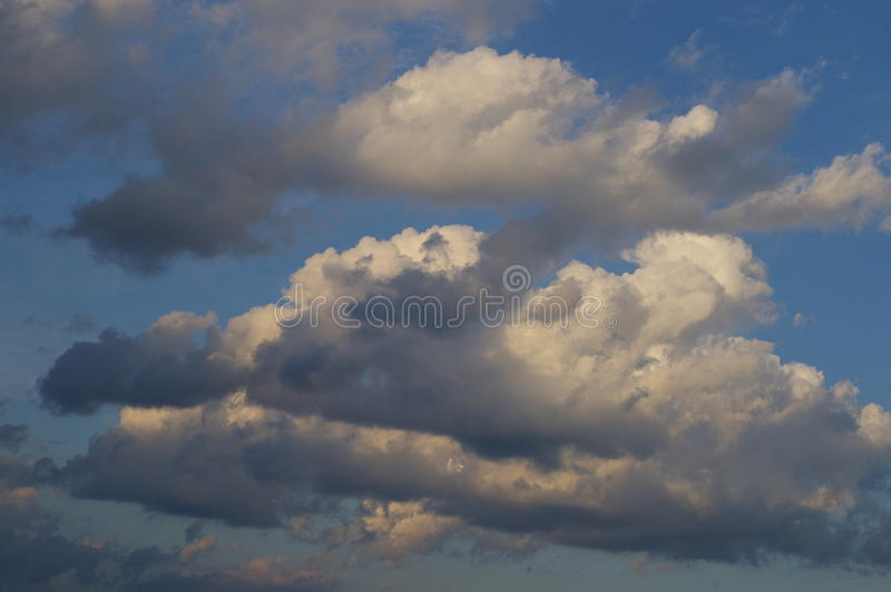 Clouds in a blue sky stock images
