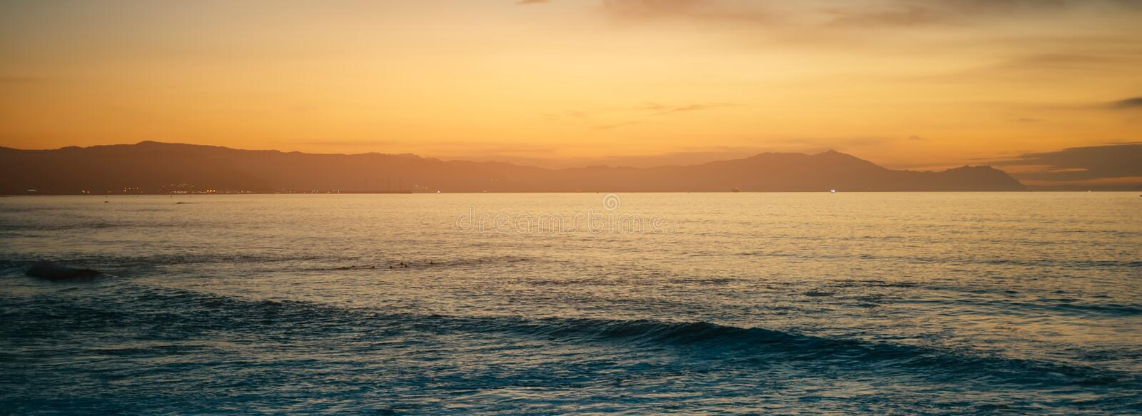 Clouds blue sky and gold sunlight sunset on horizon ocean, background seascape dramatic atmosphere rays sunrise. Relax view waves stock images