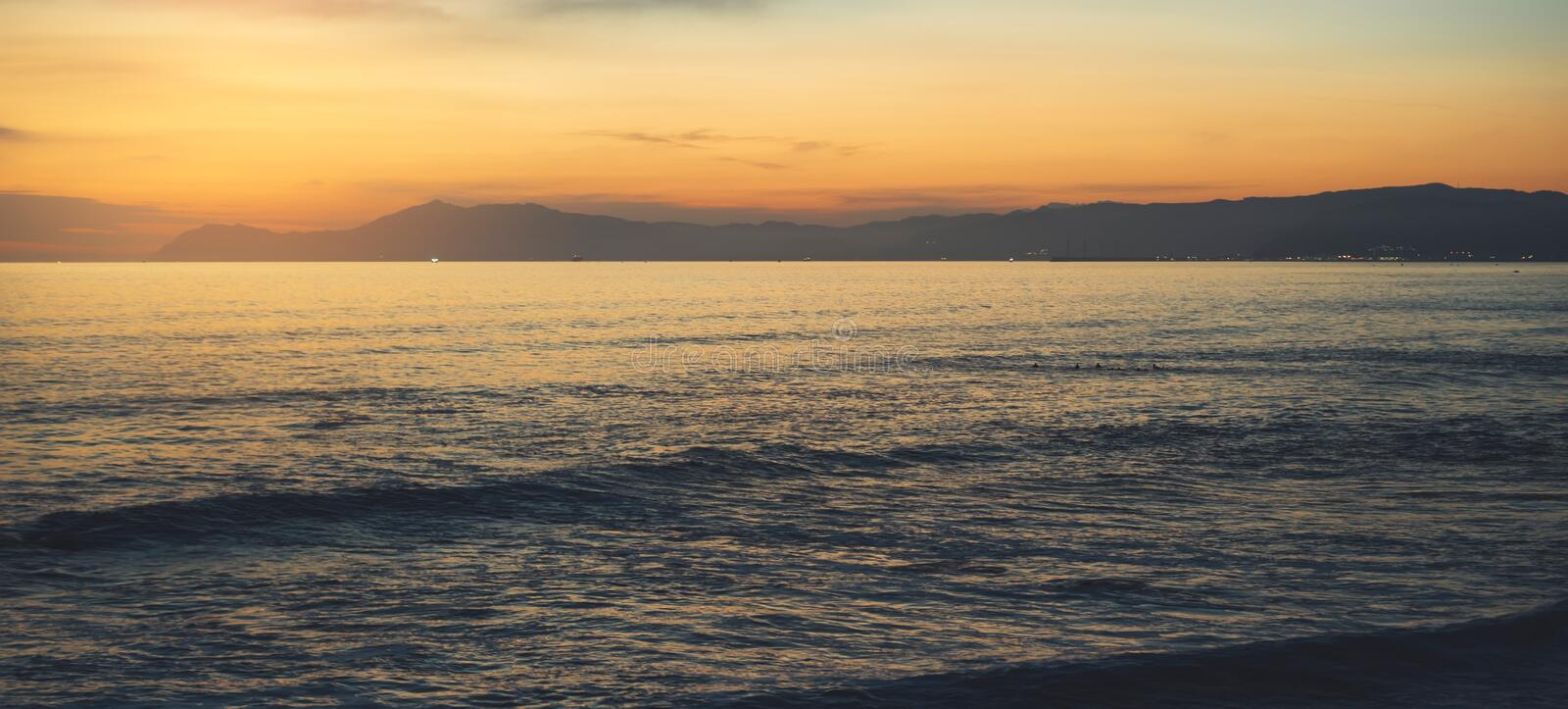 Clouds blue sky and gold sunlight sunset on horizon ocean, background seascape dramatic atmosphere rays sunrise. Relax view waves stock photos