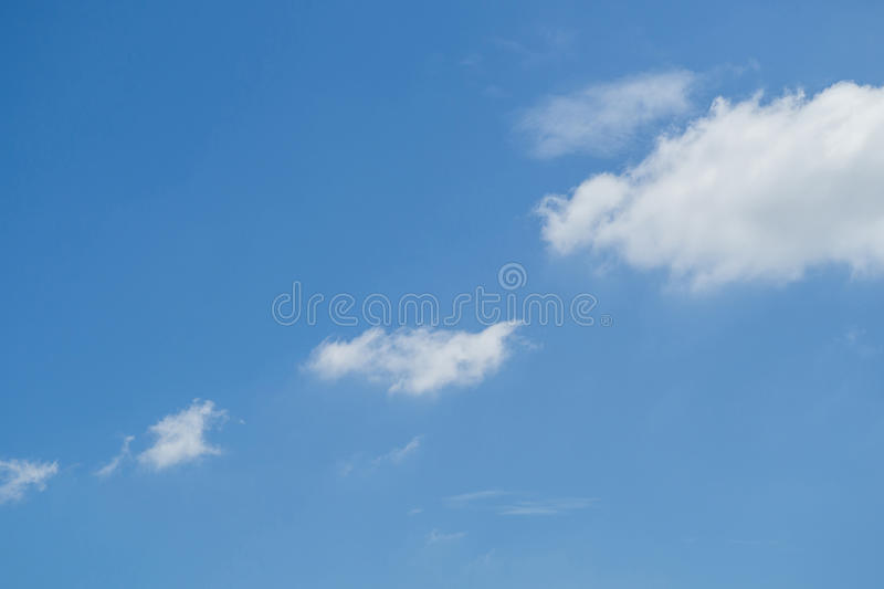 Clouds in the blue sky at noon. Clouds in the blue sky at noon in sun shine stock images