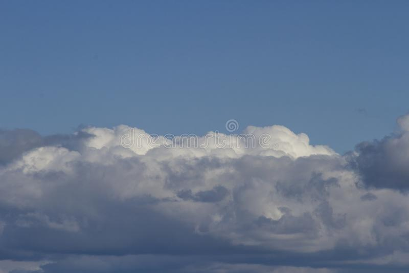 Clouds in heaven with a smile royalty free stock image