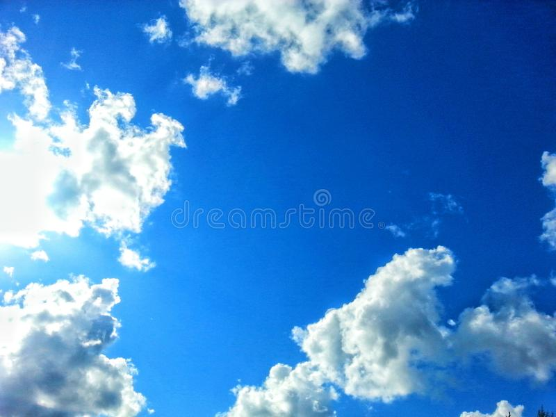 Clouds on the blue sky stock image