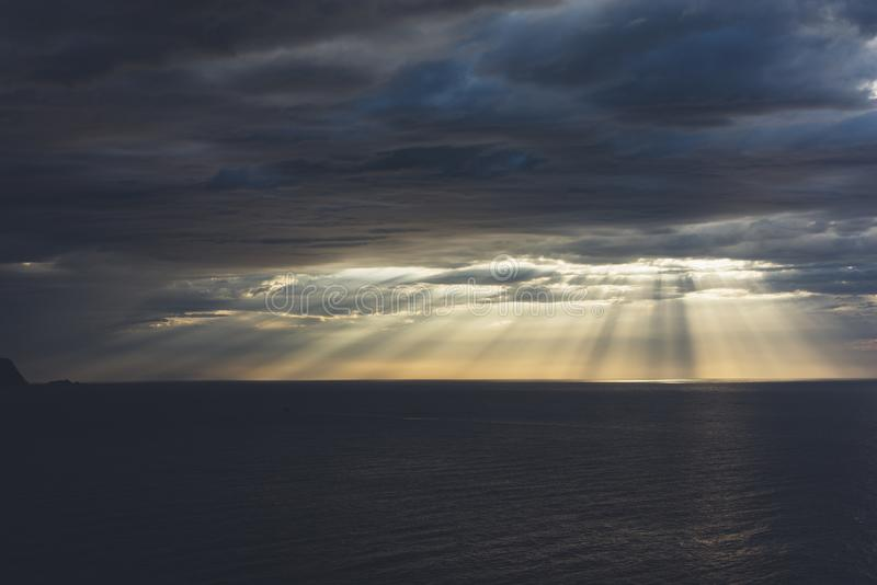 Clouds blue sky and sunlight sunset on horizon ocean . Ð¡loudscape on background seascape dramatic atmosphere rays sunrise. Relax. View waves sea, mockup stock image
