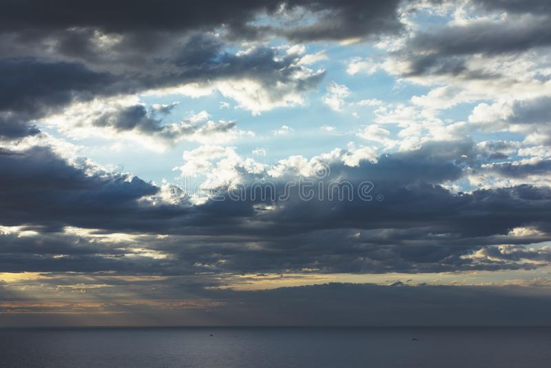 Clouds blue sky and sunlight sunset on horizon ocean. Ð¡loudscape on background seascape dramatic atmosphere rays sunrise. Relax. View waves sea, mockup stock photography
