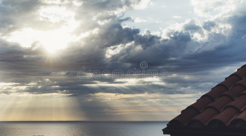 Clouds blue sky and sunlight sunset on horizon ocean . Ð¡loudscape on background seascape dramatic atmosphere rays sunrise. Relax. View waves sea with ship royalty free stock photos