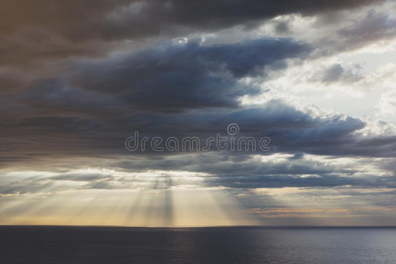 Clouds blue sky and sunlight sunset on horizon ocean . Ð¡loudscape on background seascape dramatic atmosphere rays sunrise. Relax. View waves sea, mockup royalty free stock photography