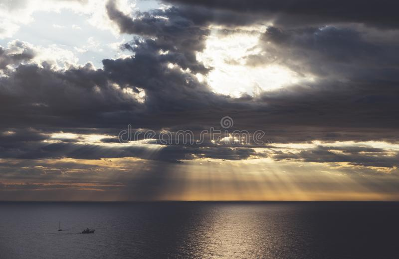 Clouds blue sky and sunlight sunset on horizon ocean . Ð¡loudscape on background seascape dramatic atmosphere rays sunrise. Relax. View waves sea with ship royalty free stock images