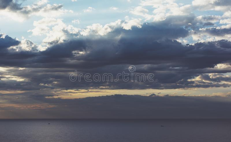 Clouds blue sky and sunlight sunset on horizon ocean. Ð¡loudscape on background seascape dramatic atmosphere rays sunrise. Relax. View waves sea, mockup royalty free stock photography