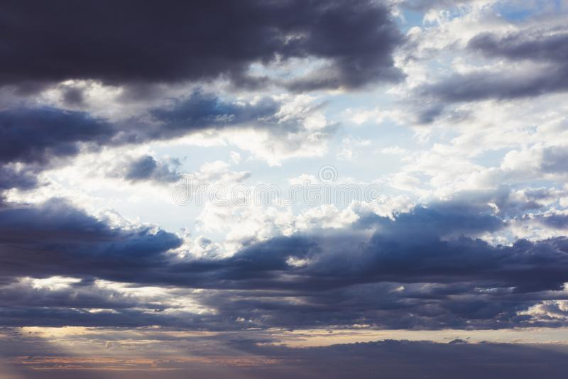 Clouds blue sky and sunlight sunset on horizon ocean. Ð¡loudscape on background seascape dramatic atmosphere rays sunrise. Relax. View waves sea, mockup stock image