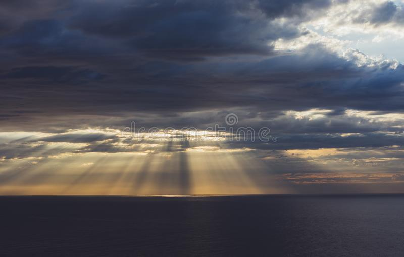Clouds blue sky and sunlight sunset on horizon ocean . Ð¡loudscape on background seascape dramatic atmosphere rays sunrise. Relax. View waves sea, mockup royalty free stock photos