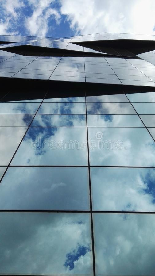 Clouds in building royalty free stock photos