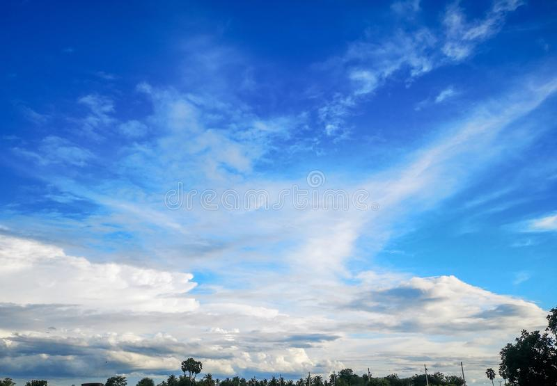 Clouds that are on the clear sky above the fields royalty free stock image
