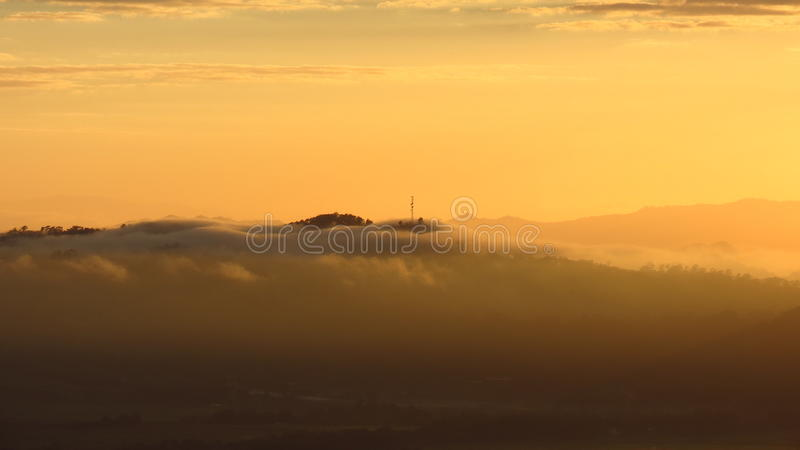 Clouds covering the hill royalty free stock photography