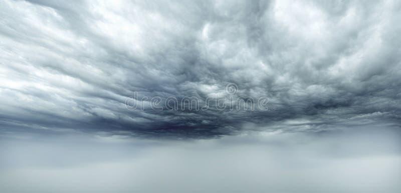 Clouds. Dark storm clouds sky. Copy space below royalty free stock photo