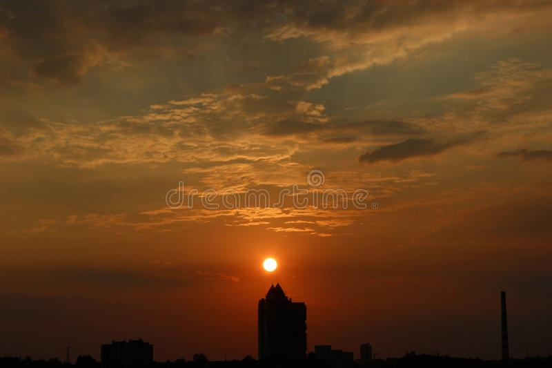 Clouds at dawn. Fiery red rising sun behind the clouds. headpiece royalty free stock photography