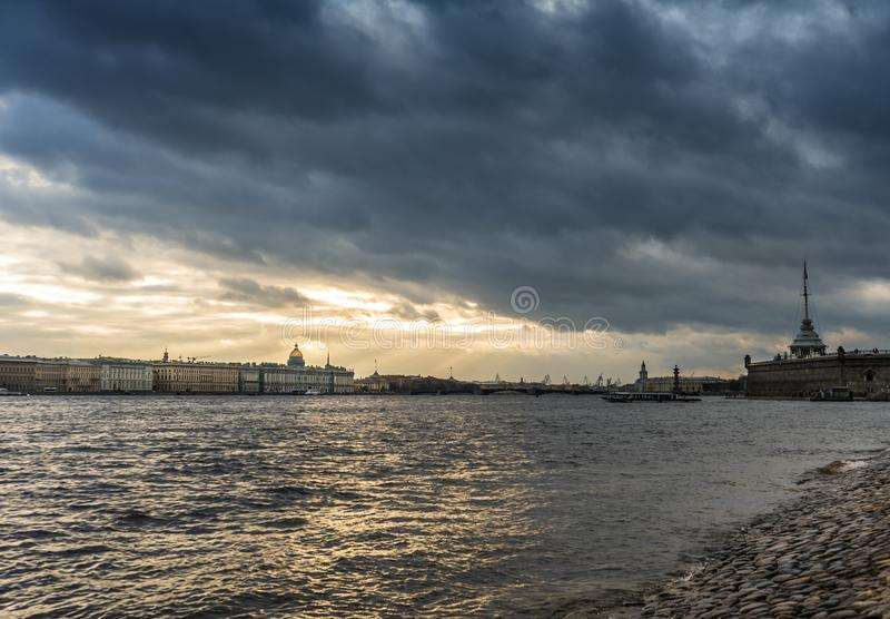 Sky clouds Saint-Petersburg river embankment historical building. Clouds day sky river water Saint-Petersburg royalty free stock photography