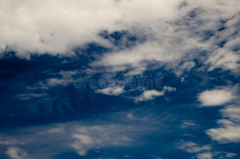 Clouds and deep blue sky royalty free stock images